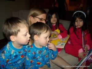Tracey is reading to our two sets of twins.