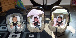 3 infants buckled up at home: Grocery Shopping with Multiples from hdydi.com