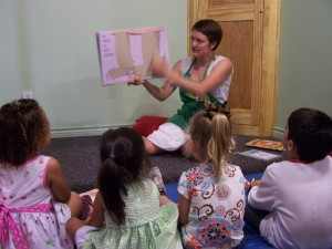 Teacher reading to kids: daycare costs from hdydi.com