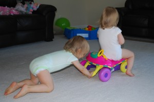 Each of our girls had a car.  Many times, they both played...but just as often, they loved to push each other.  Teamwork!!!