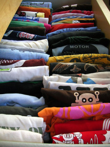 An alternative to stacking folded clothes in drawers is to place them vertically, with the fold up. This allows you to see all your kids' clothes at once. Note that this system is frustrating for kids who put away their own clothes. They can retrieve their favourite item easily, but putting the clothes away and keeping them folded requires some mature dexterity. Photo Credit: peyri