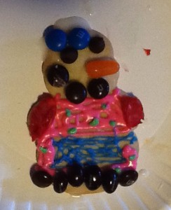 Candy-covered snowman cookie from a cookie decorating party!