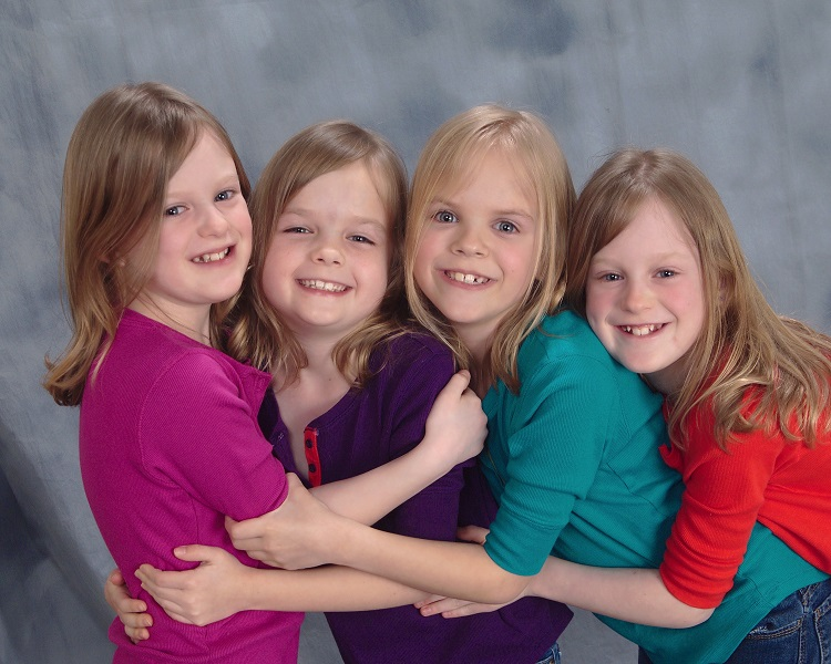 8 year old quadruplet sisters. You'd never guess they were born at 28 weeks and spents months in the NICU!