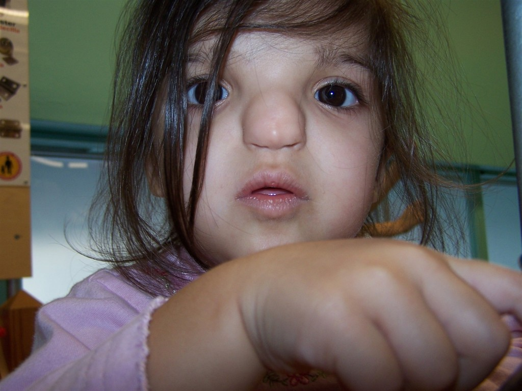 This face delivered the news of poop on the wall. Because twins will try to change one another's diapers if they can.