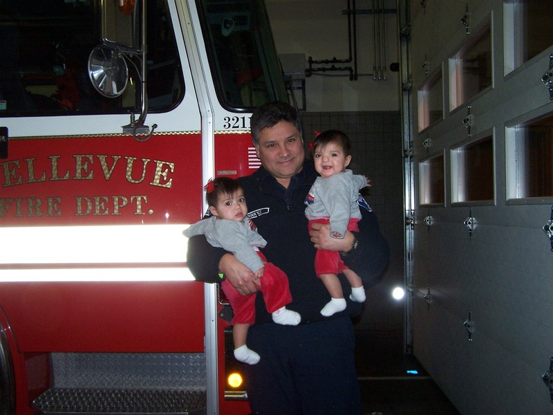 Proud Grandpa displaying his grandtwins at the fire station