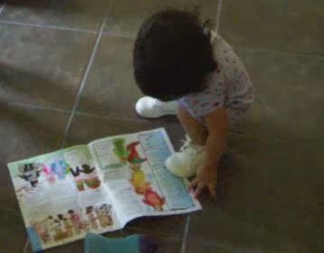Let toddlers look through catalogs and magazines.