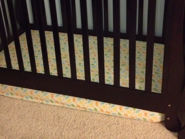My son's new crib. While standing in it, the top of his head barely makes it to the railing.