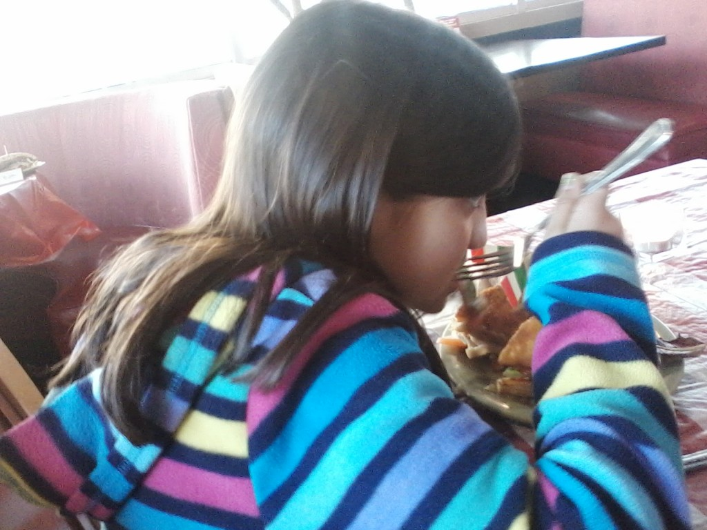 8-year-old J is chowing down at Schlotzsky's