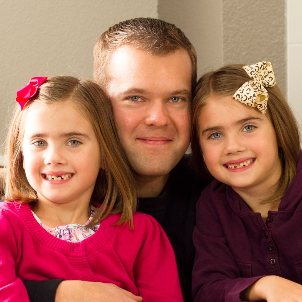 Joe Rawlinson, author of Dad's Guide to Twins, with his identical daughters.