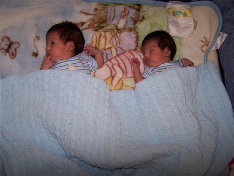 Newborn twins, placed a few inches apart, find that expanse to be far too wide for comfort.