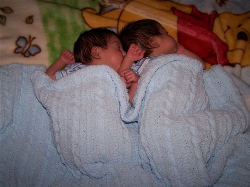 Newborn twins seek each out the comfort of their wombmate.