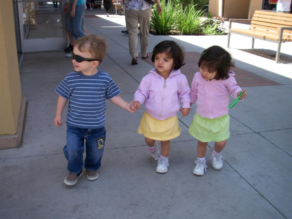 The Three Musketeers at the mall. Holding hands keeps them headed in generally the same direction, make moms' lives a little easier.