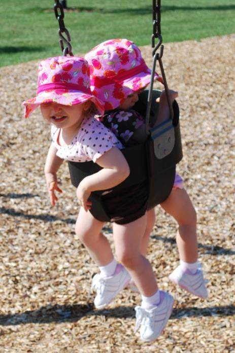 What is cuter than a baby in a bucket swing? Twins in a bucket swing!