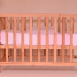 Baby crib (US) = cot (UK). In the UK</td> <td > a crib refers to what Americans might call a cradle.