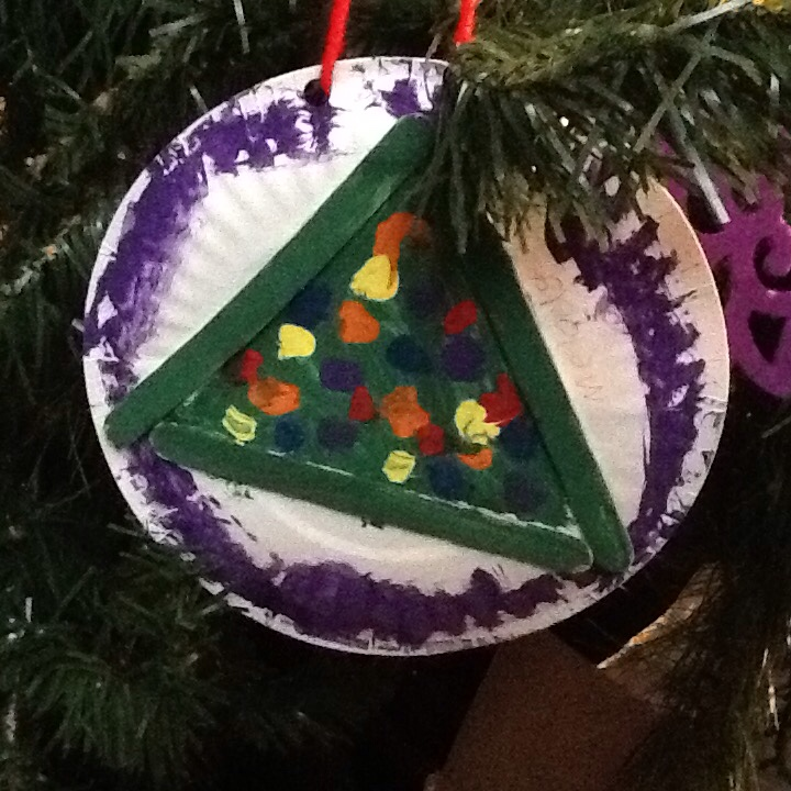 Popsicle sticks, paper plates, glue, and paint make for an easy Christmas ornament for little artists.