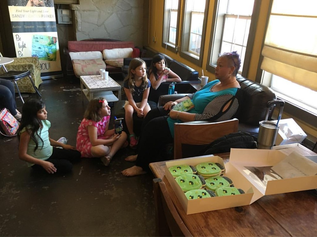 Author Sandy Parker reads her book Lumi Finds Her Light to kids in Austin TX