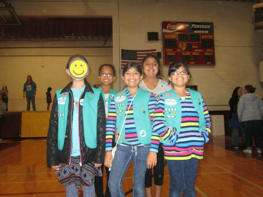5 Girl Scouts posing. Girl Scout leaders get to experience a massive variation in abilities and interests. The the identical twin kids are different!